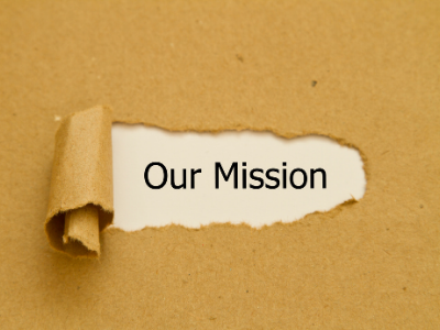 """piece of paper ripped to reveal the words """"our mission"""""""