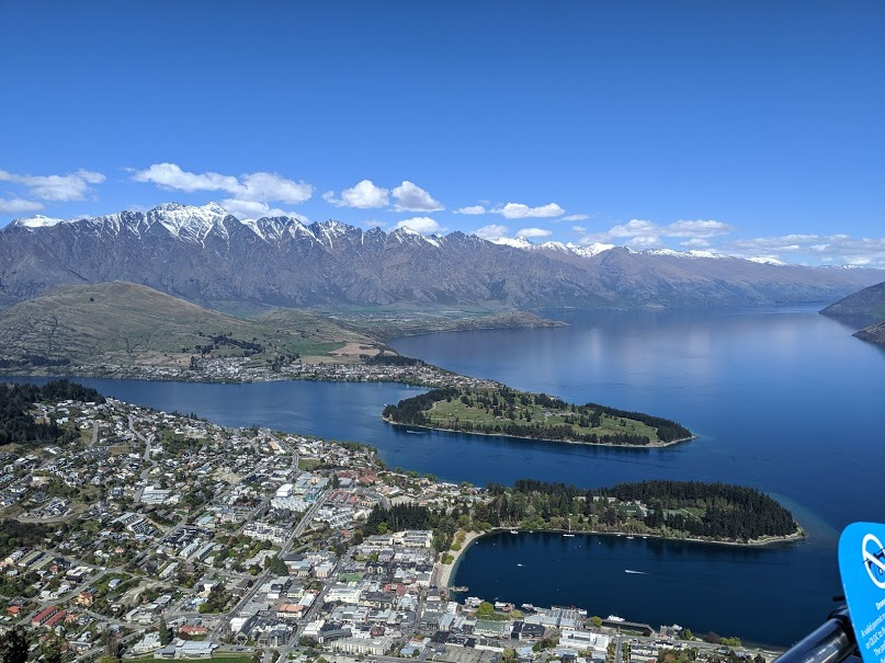 Queenstown New Zealand from atop a hill overlooking the city and lake